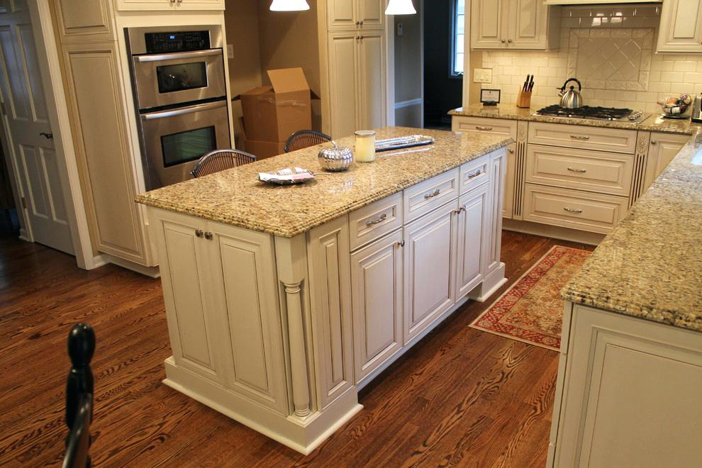 off white cabinets with granite countertops image by kitchen bath centers white cabinets dark granite countertops