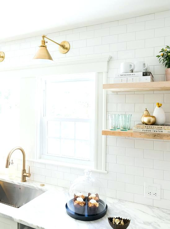 champagne bronze cabinet hardware white and gold kitchen features white shaker cabinets adorned with brass pulls paired with marble and a white subway tile delta champagne bronze cabinet hardware