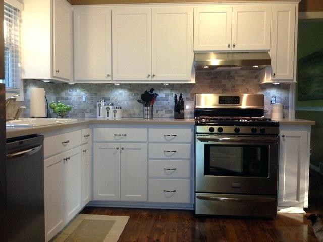 refacing thermofoil kitchen cabinets kitchen cabinet refacing done in snow white traditional kitchen painting thermofoil kitchen cabinets